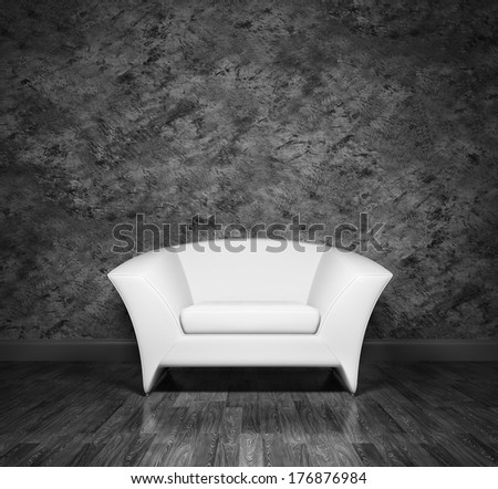 Modern white armchair over the black stucco wall - stock photo