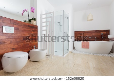 Modern white bathroom with shower and bath - stock photo