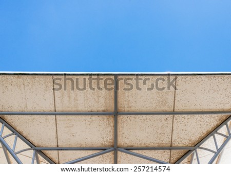 Modern white canopy under the clear blue sky.
