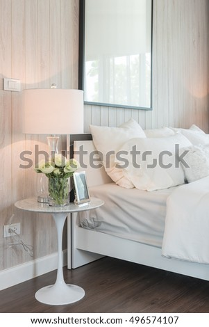 modern white color tone bedroom design with modern lamp