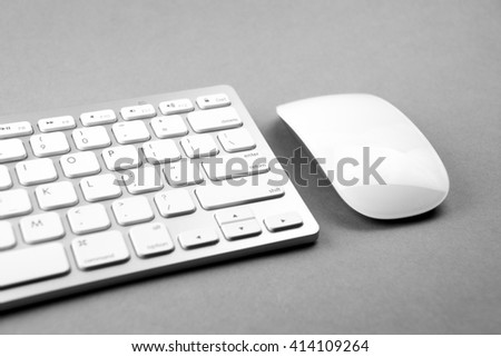 Modern & white computer mouse and keyboard