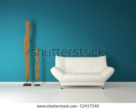 Modern white couch and abstract sculptures - stock photo
