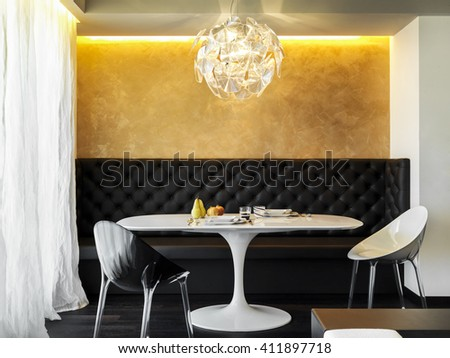 modern white dining table and chairs in the modern living room with chandelier - stock photo