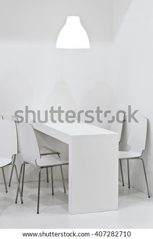 Modern white dining table in interior - stock photo