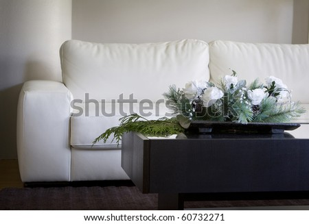 modern white floral centerpiece in contemporary living room for christmas