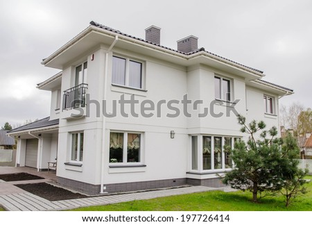 Modern white house with the garden  - stock photo