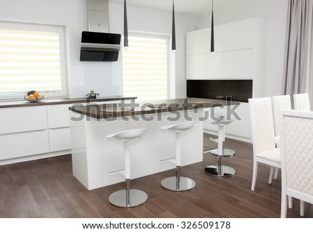 Modern white kitchen with solid wood tabletops