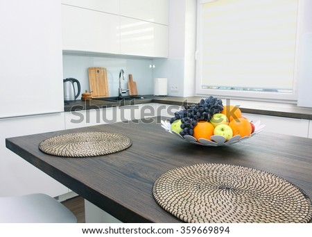 Modern white kitchen with solid wood tabletops - stock photo
