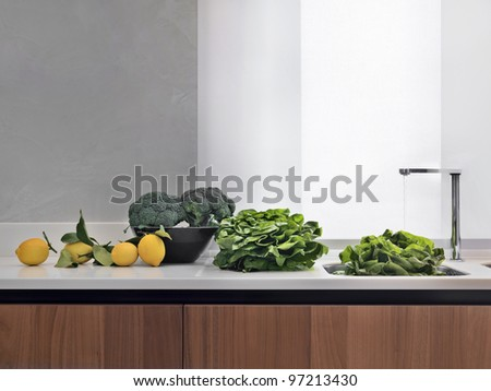 modern white kitchen with wood floor - stock photo