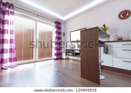 Modern white living room interior with purple curtains - stock photo