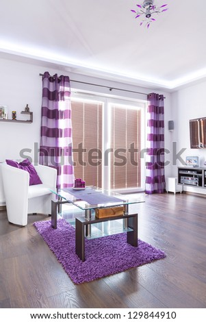 Modern white living room interior with purple decorations - stock photo