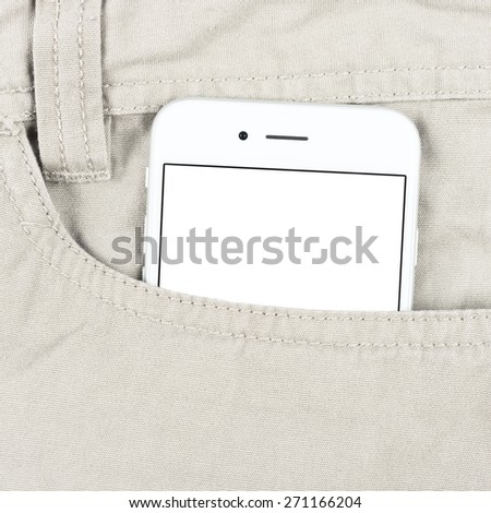 Modern white smartphone in the pocket with blank screen - stock photo