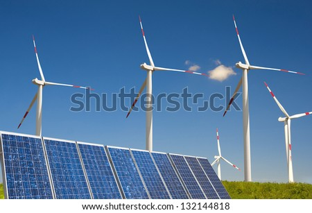 modern white wind turbine with a photovoltaic installation - stock photo