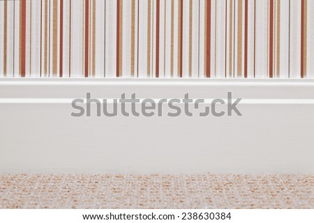 Modern white wooden skirting board - stock photo
