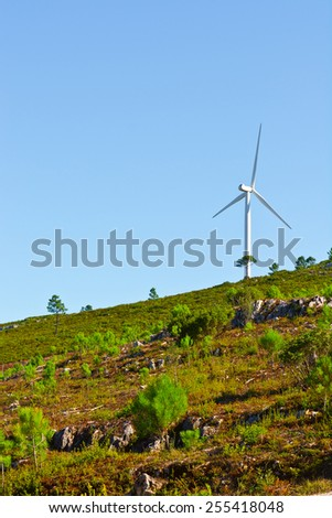 Modern Wind Turbine Producing Energy in Portugal - stock photo