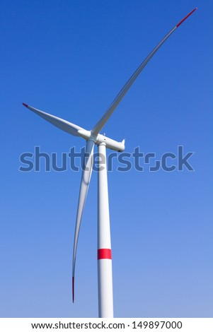 Modern wind turbine with blue sky