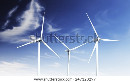 Modern wind turbines in a summer setting.