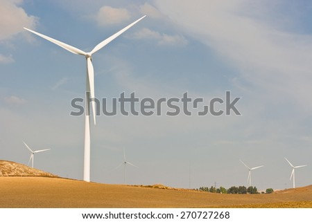 Modern Wind Turbines Producing Energy in Spain - stock photo