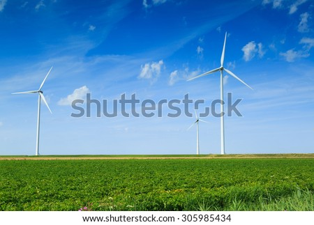 Modern wind turbines spinning and generating clean and renewable energy in the countryside. - stock photo