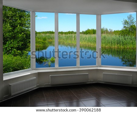 modern window of veranda overlooking the landscape with river