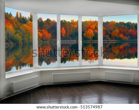 modern window overlooking the autumnal forest lake