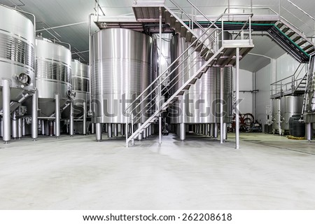 modern wine cellar with stainless steel tanks - stock photo
