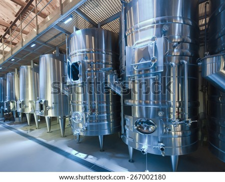 modern winery with  stell barrels - stock photo
