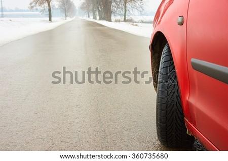 Modern winter tyre on ice.                       - stock photo