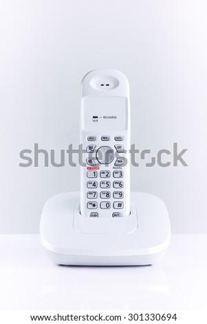 Modern wireless office phone on white background - stock photo