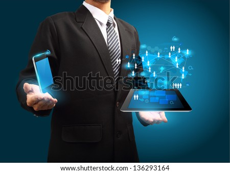 Modern wireless technology and social media concept, Mobile phone with tablet computer in the hand - stock photo