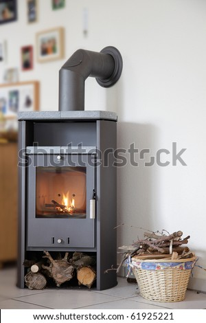 modern wood burning stove inside cozy living room