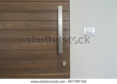 modern wood door and silver handle and light switch on wall - can use to display or montage on product