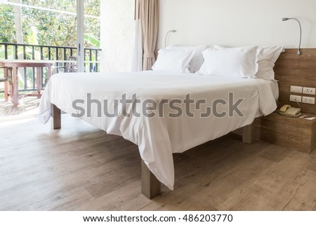 modern wooden bedroom with white pillow