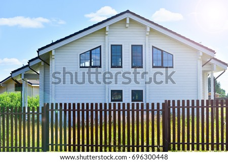 Modern wooden house and windows.