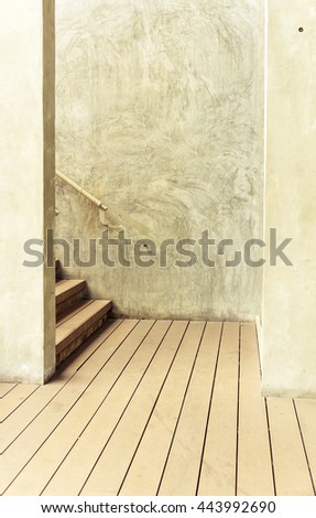 Modern wooden staircase on cement wall