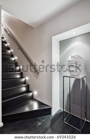 modern wooden staircase with discrete floor lighting - stock photo