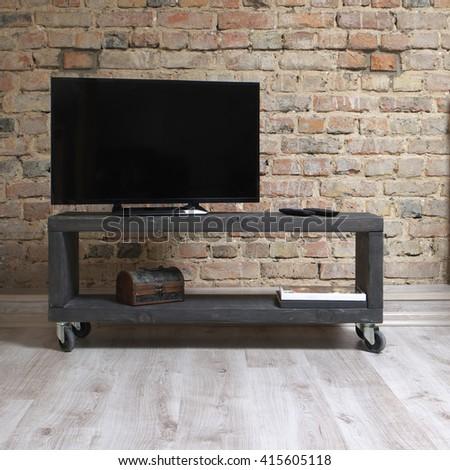 modern wooden tv unit in the loft interior  - stock photo