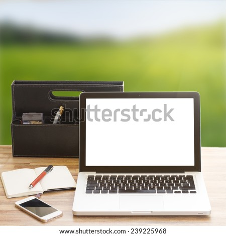 Modern working place with computer and  notebook in garden - stock photo