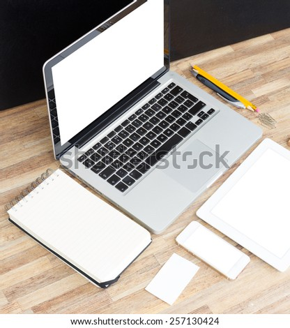 Modern working table top with empty computer, tablet, phone  and  notebook - stock photo