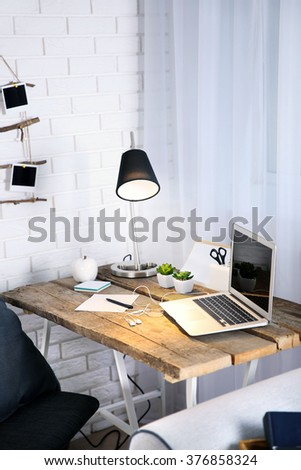 Modern workplace on light background - stock photo