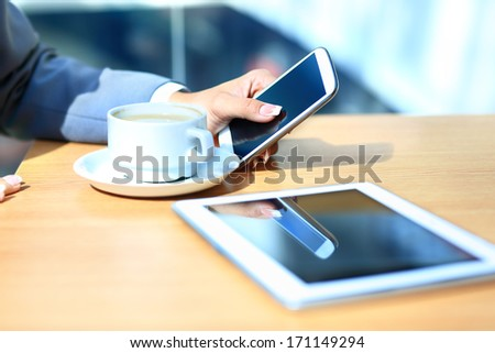 Modern workplace with digital tablet computer and mobile phone, cup of tea - stock photo