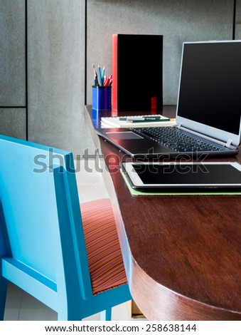 Modern workplace with laptop computer and tablet on desktop - stock photo