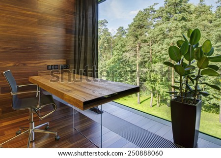 Modern workplace with panoramic window in luxury home - stock photo