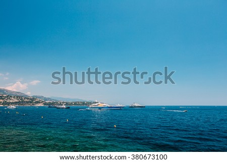 Modern Yacht in Bay In Sunny Summer Day. Luxury Vacation on sea. Copy space
