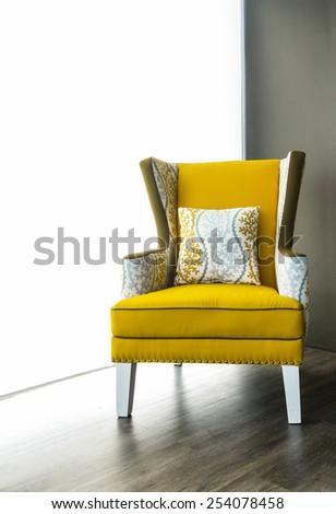 Modern yellow armchair - stock photo