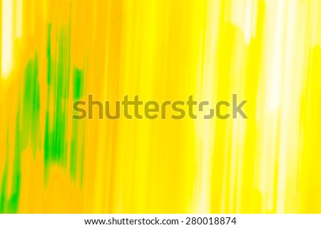 Modern yellow, orange, green vibrant background shot long exposure technique - stock photo