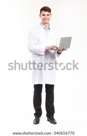 Modern young doctor with laptop. Healthcare, profession and medicine concept - smiling male doctor in white coat over white background - stock photo