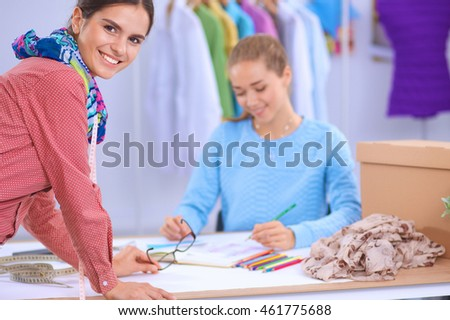 Modern young fashion designers working at studio.