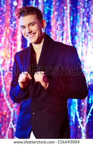 Modern young man at the night party. Disco lights. - stock photo