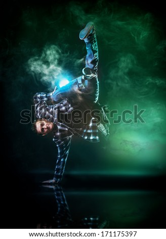 Modern young man dancer dancing at studio.